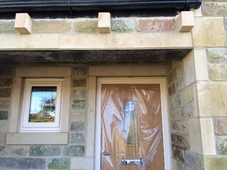 New cut stone quoins, heads, cills, jambs and lintels